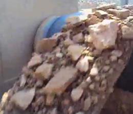 Video of Skalper IV in application on hard rock conveyor.